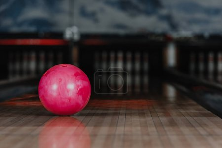 close-up shot of red bowling ball lying on alley