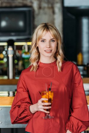 attractive young woman with cocktail spending time in bar