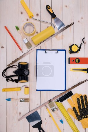 Photo for Top view of set of construction tools and blank clipboard - Royalty Free Image