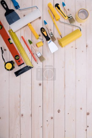 Top view of set of construction tools on wooden table
