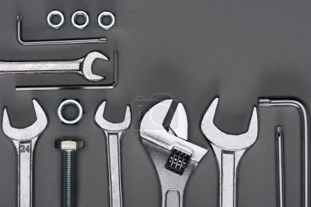 top view of set of various work tools on grey