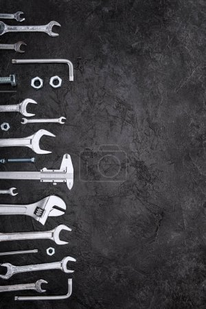 Photo for Top view of set of various work tools on grey - Royalty Free Image