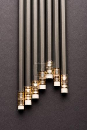 Photo for Close-up top view of new lead pencils on black - Royalty Free Image