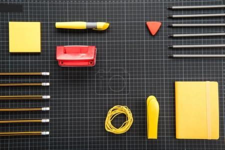 Photo for Top view of organized various office supplies on black - Royalty Free Image