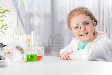 girl in goggles with flasks
