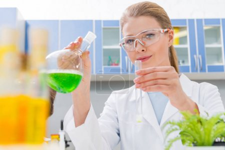 Scientist working with reagents