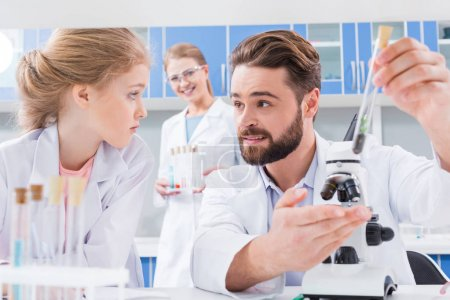 Teachers and student in lab