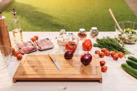 Vegetables and meat on table