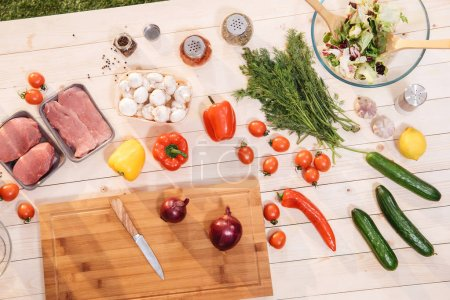 Photo for Close-up view of fresh vegetables and raw meat on wooden table - Royalty Free Image