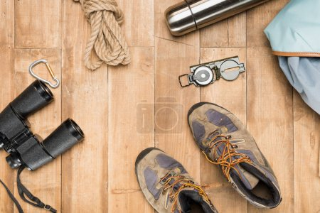 Photo for Traveler set on wooden background, flat lay - Royalty Free Image