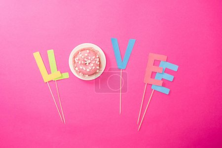 Love sign made from letters and donut