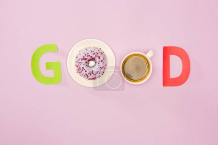 Photo for Top view of Good word made from donuts and cup of coffee isolated on pink - Royalty Free Image