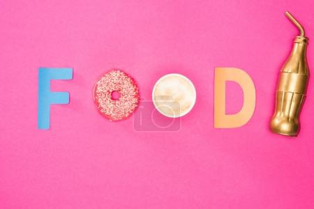 Photo for Top view of food word made from donuts and coffee isolated on pink. junk food background - Royalty Free Image