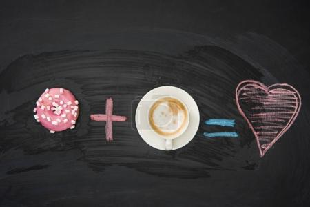 Photo for Food composition of donut with pink glaze and cup of coffee on black surface. donuts and coffee concept - Royalty Free Image