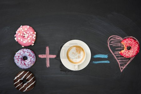 Photo for Food composition with several donuts and cup of coffee on black surface. donuts and coffee concept - Royalty Free Image
