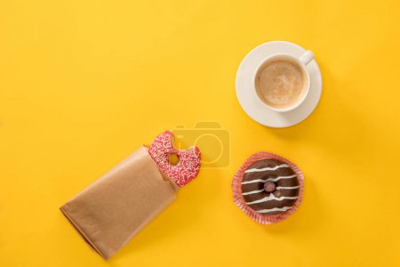 Photo for Top view of cup of coffee with donuts on yellow surface. donuts and coffee background - Royalty Free Image