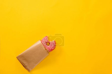 Bitten doughnut in pink icing