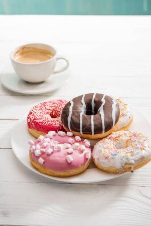Donuts with cup of coffee for breakfast