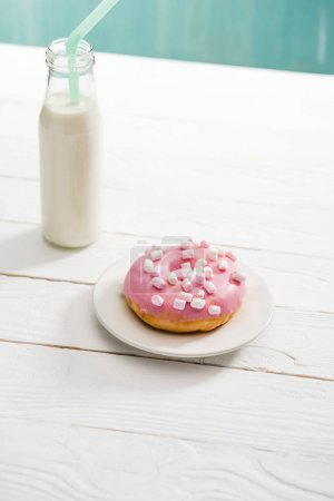 Donut with pink icing and milkshake