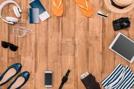 Photo for Planning for trip set of travel accessories on wooden background. Gadgets, clothes, passports on the floor. - Royalty Free Image