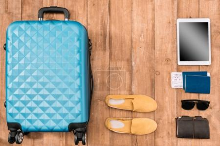 Flat lay with travel accessories on the floor