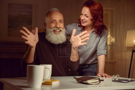 red hair woman with mature man
