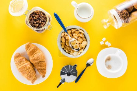 Photo for Top view of tasty breakfast with cereal flakes and croissants with coffee - Royalty Free Image