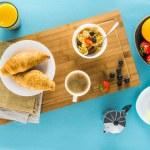 Постер, плакат: croissants with berries and coffee and orange juice