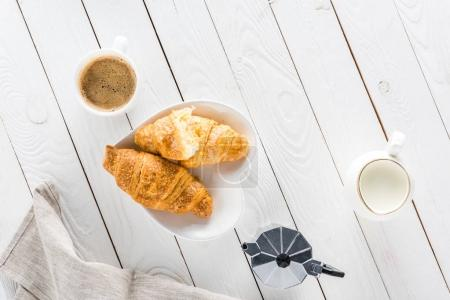 Photo for Top view of croissants with coffee and milk on wooden tabletop - Royalty Free Image