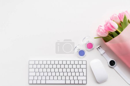 Pink tulips and keyboard