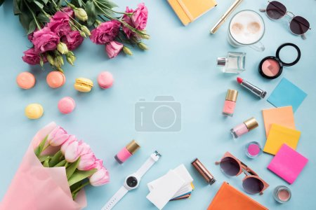 Top view of bouquets of flowers with sunglasses an...