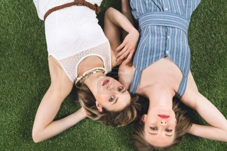 lesbian couple lying on grass