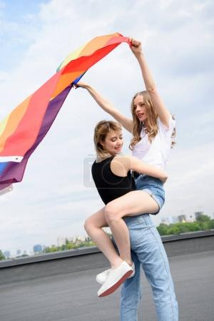 lesbian couple with lgbt flag