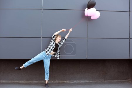 casual girl with air balloons