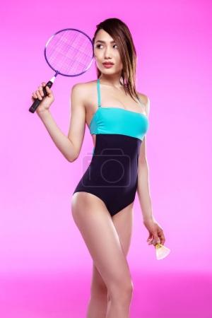 Girl in swimsuit with badminton racquet
