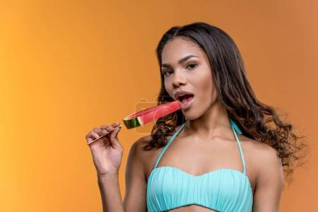 african american girl eating watermelon