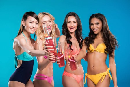 women in swimsuits clinking with cocktails