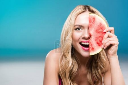 Photo for Young smiling caucasian woman holding watermelon piece in front of face - Royalty Free Image