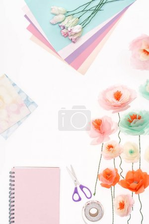 Photo for Top view of decorative flowers and stationery items isolated on white - Royalty Free Image