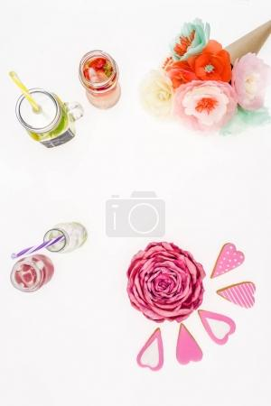 Photo for Top view of refreshing lemonades, handmade flowers and cookies isolated on white - Royalty Free Image