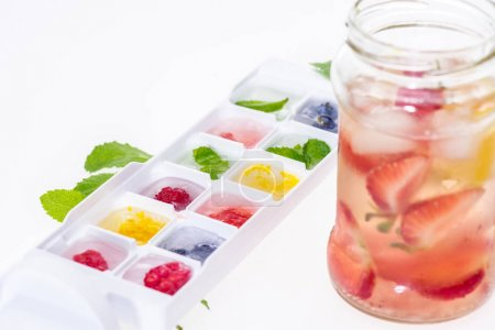 berries in ice cubes