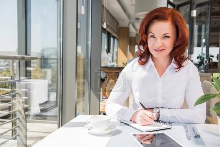 beautiful mature businesswoman in restaurant