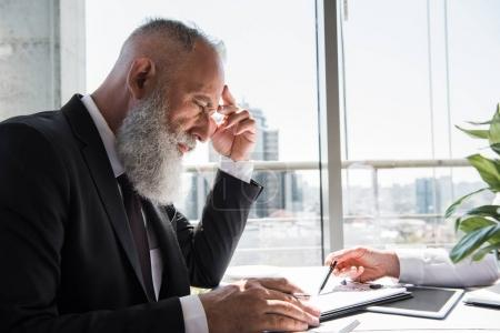 thoughtful businessman with business contract