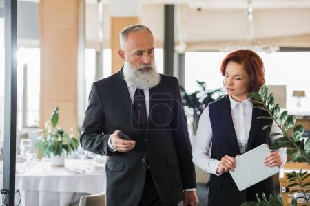business people talking in restaurant