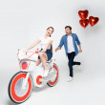 Couple having fun with electric bike