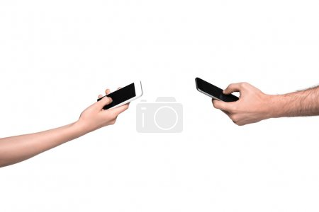 Photo for Cropped view of man and woman using smartphones, isolated on white - Royalty Free Image