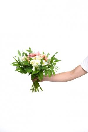 hand with bouquet of flowers
