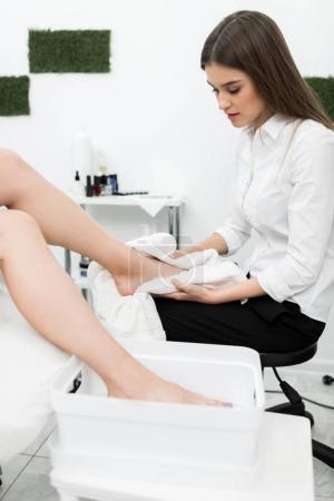 Woman getting pedicure procedures