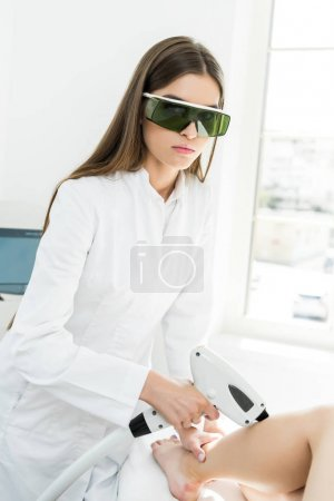 young hair removal therapist