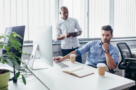 multiethnic businessmen in office
